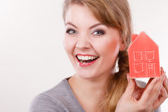 Smiling girl with home symbol. Royalty Free Stock Photos