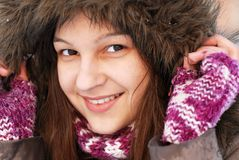 Smiling girl in hood Stock Photo