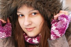 Smiling girl in hood Royalty Free Stock Images