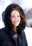 Smiling girl in the hood with fur Stock Images