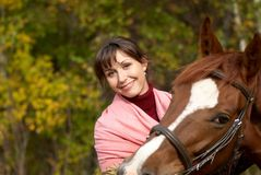 Smiling girl with horse. Young smiling girl with chestnut horse Stock Images