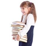 A smiling girl with a huge pile of books Royalty Free Stock Images