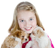 Smiling girl hugging puppies Stock Images