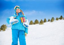 Smiling girl with ice-skates Royalty Free Stock Image