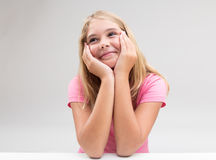 Smiling girl imagining something or dreaming Royalty Free Stock Photos