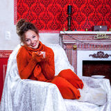 Smiling girl inside a red vintage room with christmas decoration Royalty Free Stock Photos