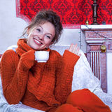 Smiling girl inside a red vintage room with christmas decoration Royalty Free Stock Images