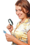 Smiling girl inspects a credit card Stock Photos