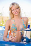 Smiling girl in Jacuzzi Stock Photography