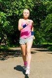 Smiling girl jogging Stock Image