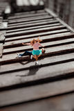 Smiling girl jumping over the man on the gray roof of apartment Stock Photography