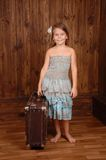 Smiling girl keep ancient brown scratched suitcase Stock Photos