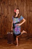 Smiling girl keep ancient brown scratched suitcase Stock Photography