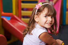 Smiling girl in kindergarten royalty free stock image