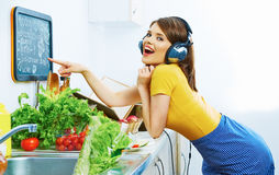 Smiling girl in kitchen cooking green diet Stock Image