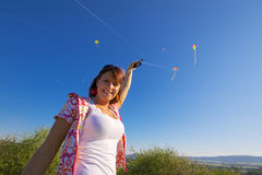 Smiling girl with kite Stock Image