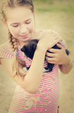 Smiling girl with kitten Stock Photography