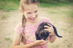 Smiling girl with kitten Royalty Free Stock Images
