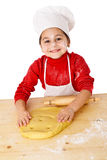 Smiling girl kneading the dough Royalty Free Stock Image