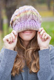 Smiling girl in a knitted hat. Smiling and having fun Royalty Free Stock Image