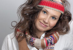 Smiling girl with a knitted hat and scarf Stock Photo