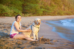 Smiling girl with labrador dog Royalty Free Stock Photography