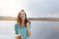 Smiling girl on the lake Royalty Free Stock Photos