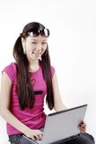 Smiling girl with laptop Royalty Free Stock Image