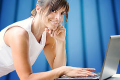 Smiling girl at laptop Royalty Free Stock Photo