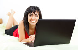 Smiling girl with laptop Royalty Free Stock Photography