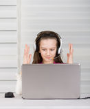 Smiling girl with laptop Stock Images