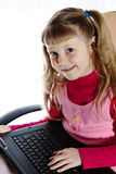 Smiling girl with laptop Royalty Free Stock Images