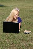 Smiling girl with a laptop Royalty Free Stock Image