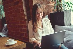 Smiling girl with laptop Stock Photography