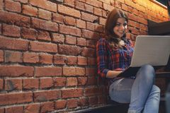 Smiling girl with laptop indoors Royalty Free Stock Images