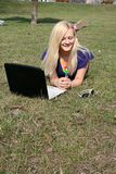 Smiling girl with a laptop outdoor Royalty Free Stock Photos