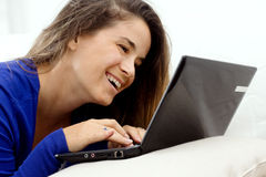 Smiling girl at laptop Stock Photography