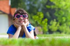 Smiling girl laying against new cottages Stock Photography