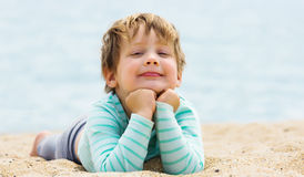 Smiling  girl laying on  beach Royalty Free Stock Images