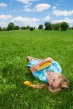 Smiling girl laying on lawn Royalty Free Stock Photography