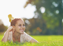 Smiling girl laying on meadow Royalty Free Stock Images