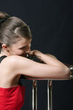 Smiling girl leaning on bar chair Royalty Free Stock Image