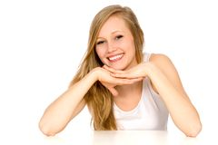 Smiling girl leaning on table Royalty Free Stock Images