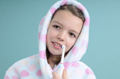 Smiling girl learning to brush teeth Royalty Free Stock Image