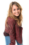 Smiling girl in leather jacket Royalty Free Stock Images