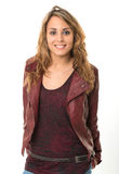 Smiling girl in leather jacket stock photos