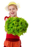 Smiling girl with lettuce salad Royalty Free Stock Photography