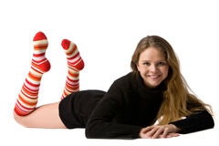 Smiling girl lies on the floor Stock Photos