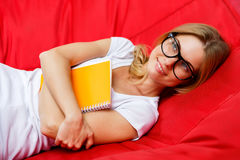 Smiling girl lies in red hammock Stock Photos