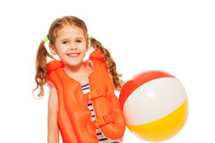 Smiling girl in lifejacket with colored wind-ball. Smiling little girl in orange lifejacket with  colored wind-ball isolated on white Stock Photo